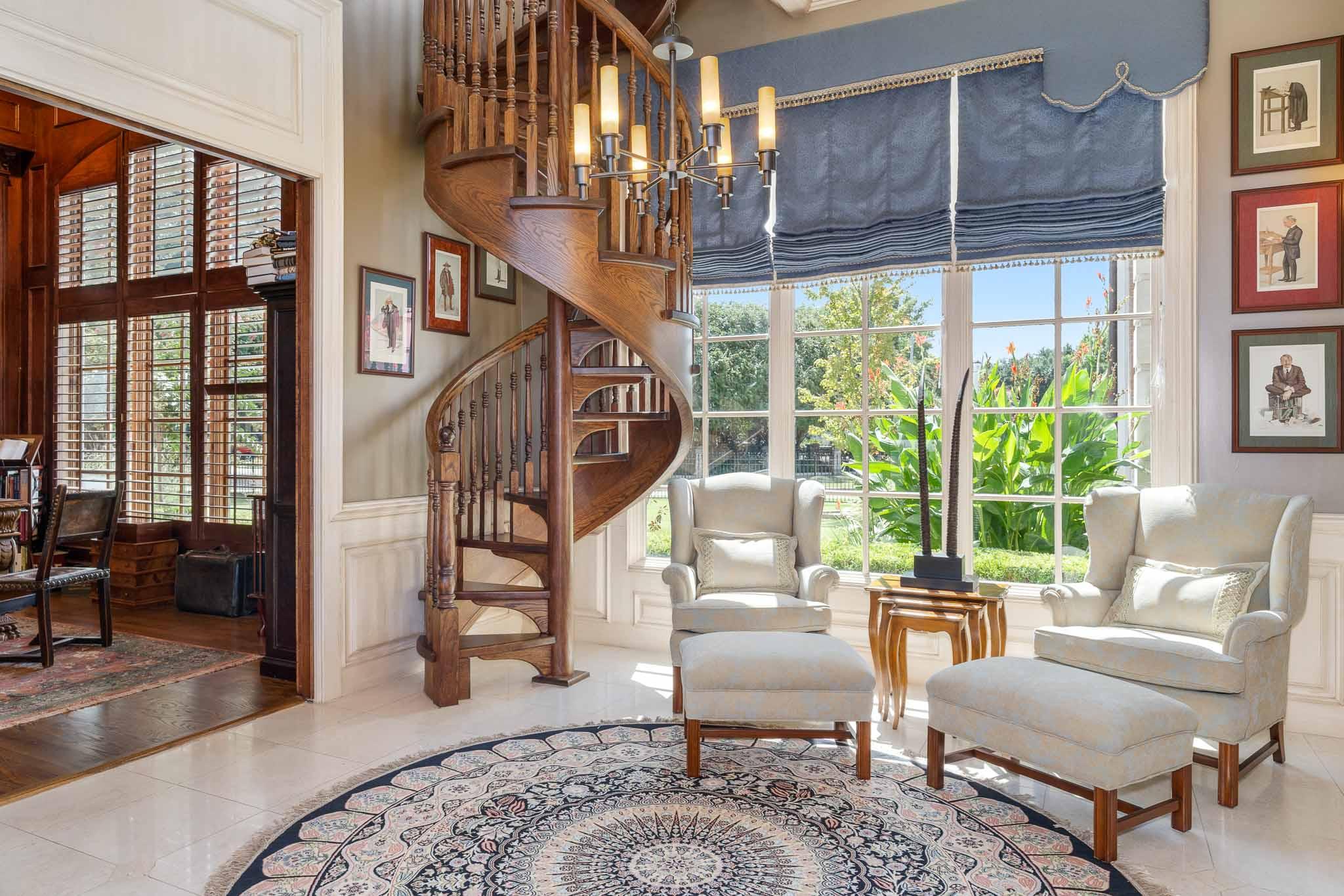 Unique staircase and formal living room in Dallas estate near Preston Hollow